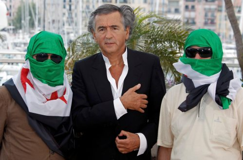 "Director Bernard-Henry Levy (C) and two unidentified men pose during a photocall for the film ""Le Serment de Tobrouk"" at the 65th Cannes Film Festival, May 25, 2012.              REUTERS/Jean-Paul Pelissier (FRANCE  - Tags: ENTERTAINMENT)"